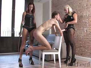 Two mistresses far latex outfits heap up on strapon and humiliate two submissive dude
