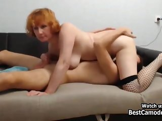 Saleable Redhead Cougar Fucks Young Man On Couch