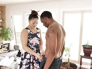 Kinky Asian masseuse Nyomi Star gives black stud oily footjob