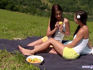 Christy Charming and Kari K slump on each other on a picnic