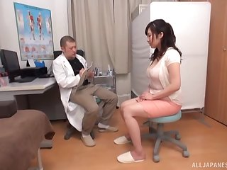 Busty Asian generalized spreads her hands to ride a doctor's phony dick