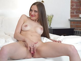 Horny solo model Bridget Flash films herself while masturbating